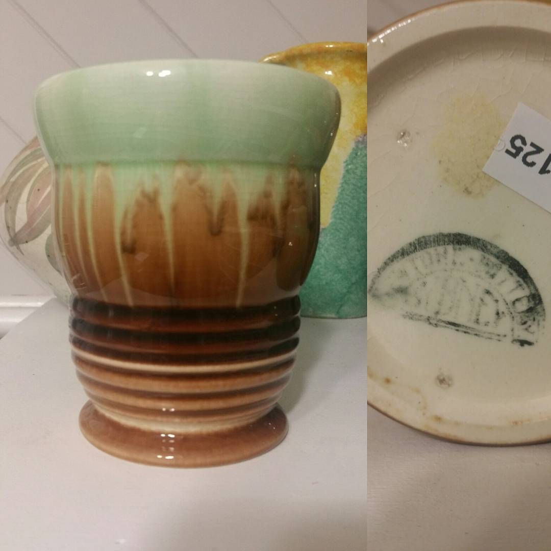 "Day 28: Today's piece is by Bakewell Bros from their Newtone Art Ware line circa 1930s. There is quite a lot going on with this piece. It's bulbous and flared at the top with a ribbed lower section. Again this piece is in the ""standard"" Newtone green and brown drip glaze. #AustralianPottery #australianceramics #AustralianArtPottery #NSWPottery #Pottery #Ceramics #instapottery #AustralianDesign #BakewellBros #Bakewells #NewtonePottery #NewtoneArtWare #Newtone #365DaysofAustralianPottery"