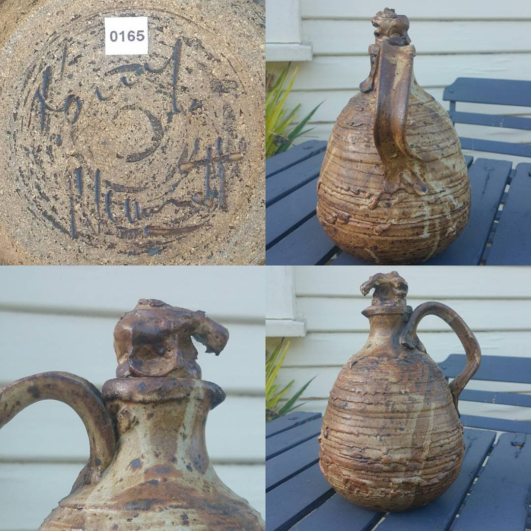 Day 36: Today's piece is by Queensland potter Harry Memmott. Known by most collectors for his souvenir wares this piece is quite different to say the least. With it's large strap handle and scrunched up stopper this jug is one helluva brute and I love it! #AustralianPottery #AustralianArtPottery #AustralianStudioPottery #australianceramics #HarryMemmott #QLDPottery #QLDArt #Pottery #instapottery #Ceramics #Brutalism #BrutalArt #BrutalPottery #365DaysofAustralianPottery