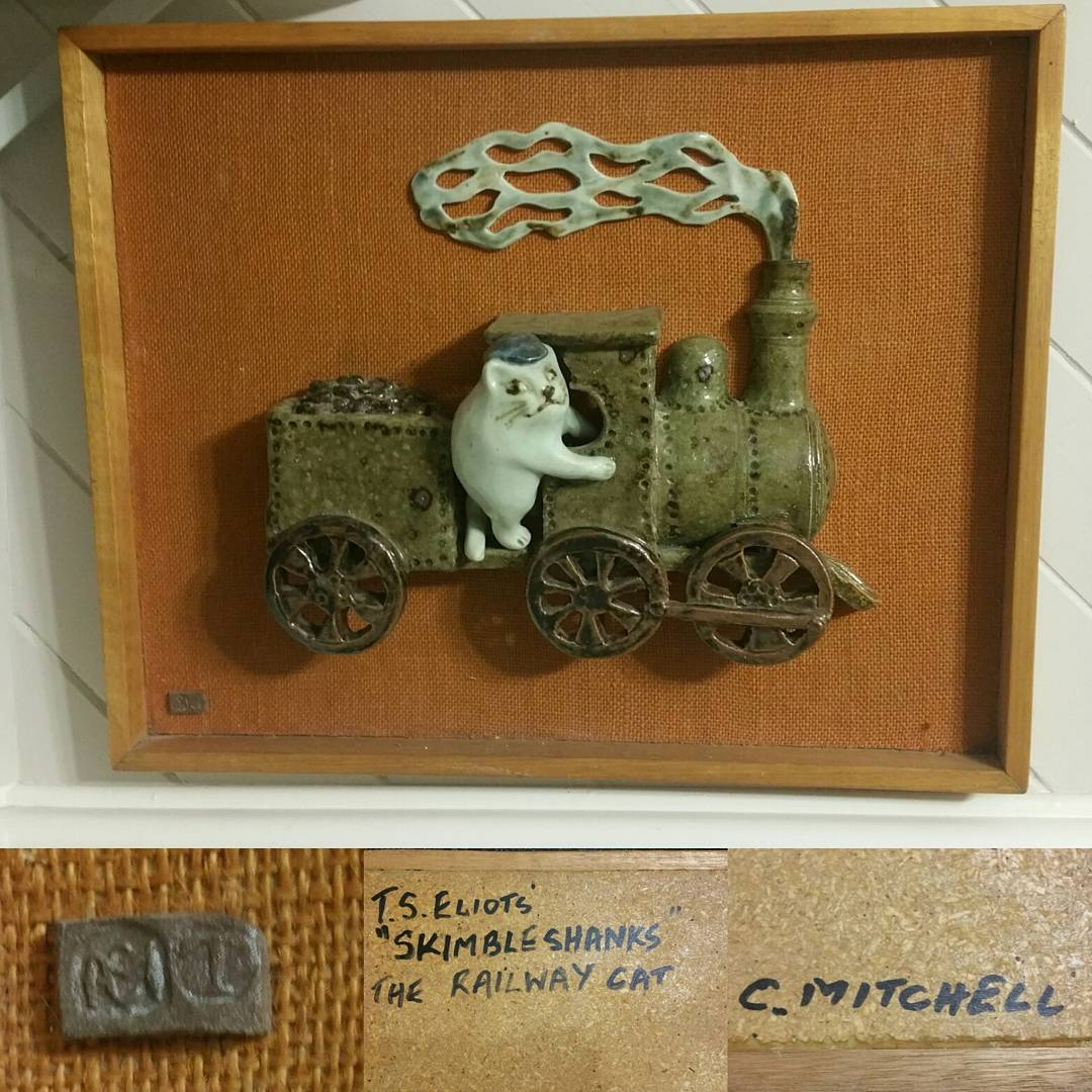 "Day 42: Today's piece is another piece by my fav post war Tasmanian potter Cynthia Mitchell and what a piece it is! This is Skimbleshanks the Railway cat who drives the mail train. He is from T.S. Eliot's, Old Possum's Book of Practical Cats. My guess is this 3D wall plaque is a complete one off. There are 14 or so poems in the book and my guess is there is a wall plaque for every poem (I know of the existence of 3 other T.S. Eliot cat plaques). I love this piece and waited a numer of years for one to turn up. I wouldn't be surprised if the ""missing"" 10 or so plaques have migrated to the mainland or indeed overseas. Fingers crossed they haven't been consigned to the land fill. @mitchellroad #lovemitchellroad #AustralianPottery #AustralianArtPottery #Pottery #Ceramics #instapottery #AustralianDesign #TasmanianPottery #TasmanianCeramics #TasmanianArt #TasmanianStudioCeramics #CynthiaMitchellPottery #CynthiaMitchell #tseliot #Skimbleshanks #Cats #Cat #Kitten #365DaysofAustralianPottery"